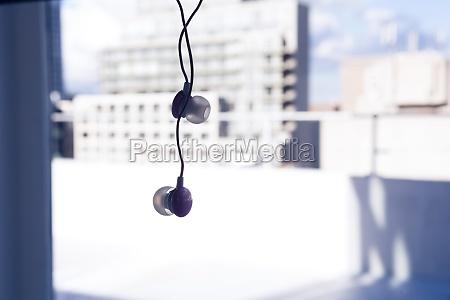earphone hanging against window