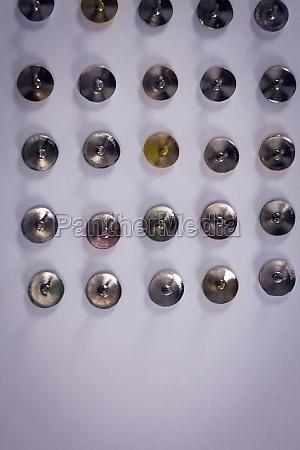 push pins arranged in a row