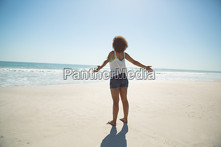 woman standing with arms outstretched on