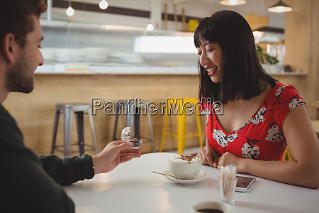 man gifting ring to girlfriend in