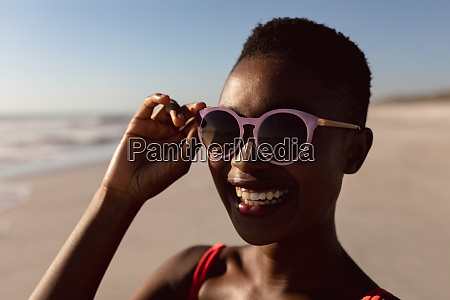 woman in sunglasses standing on the