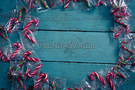 candy canes forming circle on wooden