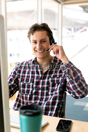 male customer service executive talking on