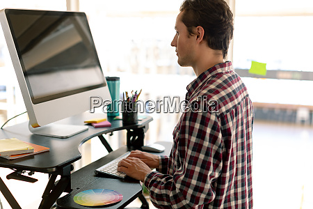male graphic designer working on computer