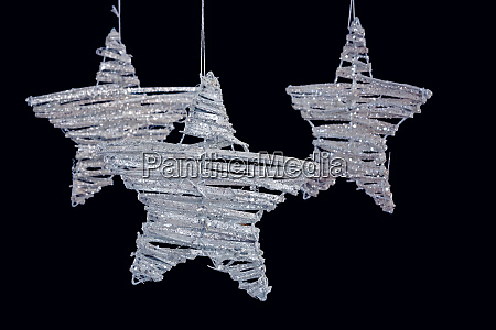 handmade stars hanging against black background