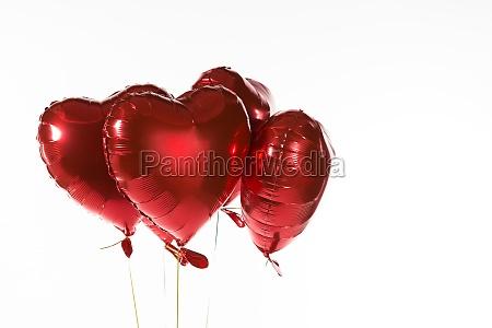 valentine balloons against white background