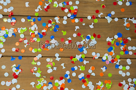 confetti on wooden surface