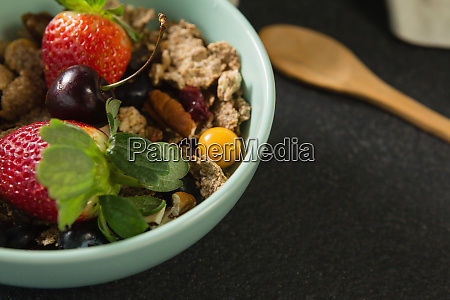 bowl of breakfast cereals with fruits