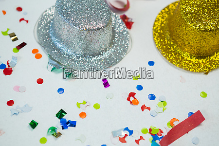 golden and silver hat with confetti