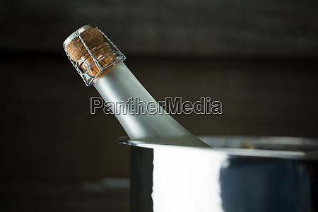 champagne bottle in a silver ice