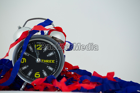 streamers with alarm clock reaching 12