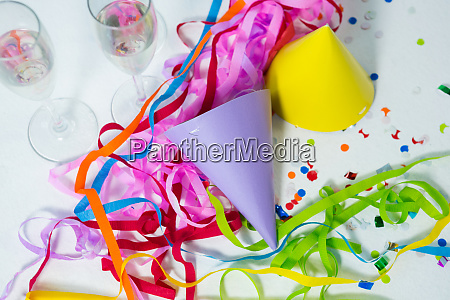 champagne flutes with party hat and