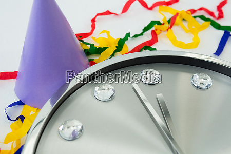 clock and streamers against white background