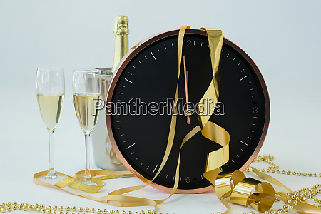 champagne with clock and glass on