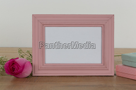 rose flower empty photo frame and