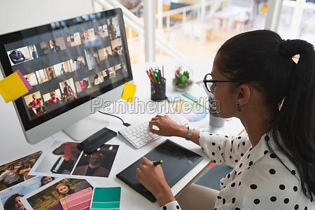 female graphic designer working on computer