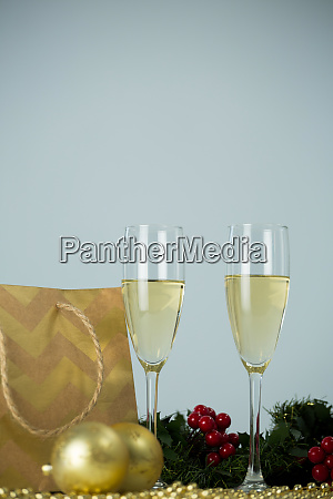 champagne flute and christmas decoration against