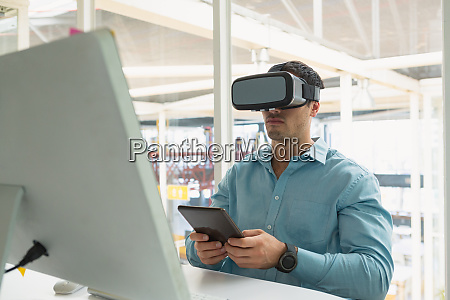 male executive holding digital tablet while