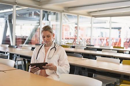female doctor using digital tablet in