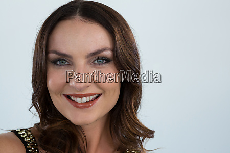 smiling woman looking at camera against