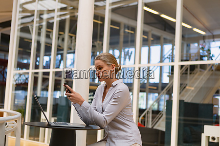businesswoman using mobile phone in the