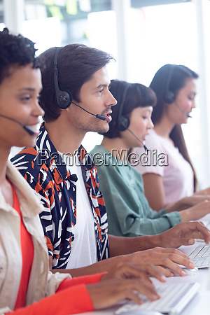 customer service executives working on computer