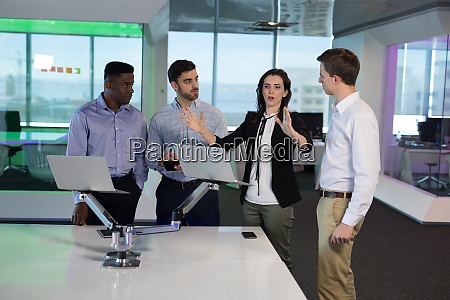 executives discussing over laptop