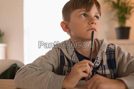 boy doing his homework at home