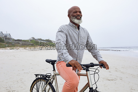 man riding a bicycle at the