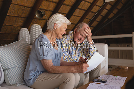 senior couple discussing over medical bills