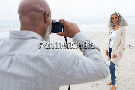 man taking a picture of woman