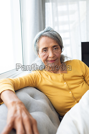 woman inside a room smiling