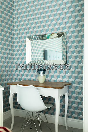 table with chair and patterned wall