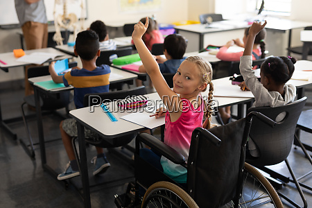 smiling disable schoolgirl looking at camera