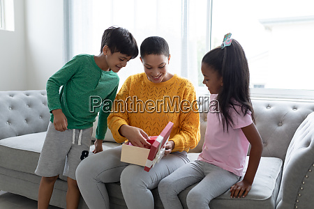 mother opening a gift box with