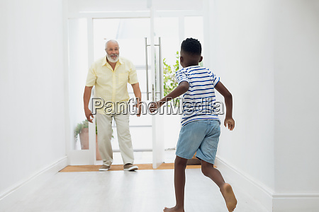 boy, running, towards, grandfather - 27577402