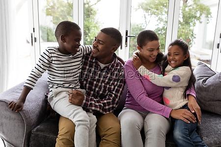 family having fun on a sofa