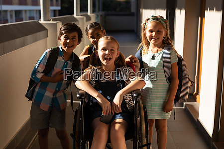 disable schoolgirl with classmates looking at