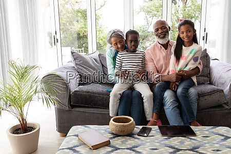 multi generation family relaxing together on