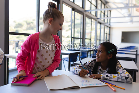 schoolkids talking with each other at