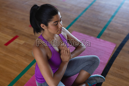 female yoga teacher doing yoga and