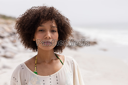 woman standing at beach on a