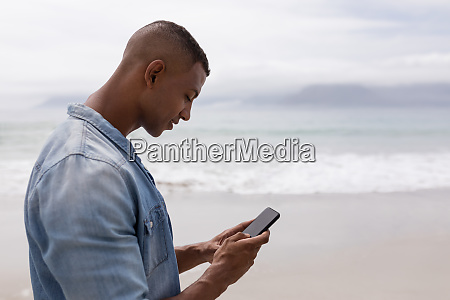 man using mobile phone on the