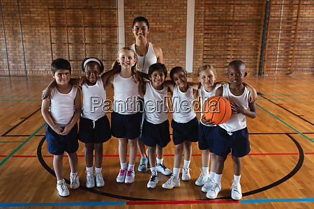 happy schoolkids and female coach looking