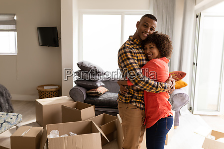 couple embracing each other in living