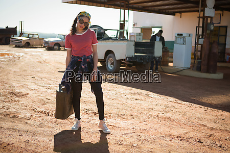 woman holding a petrol can at