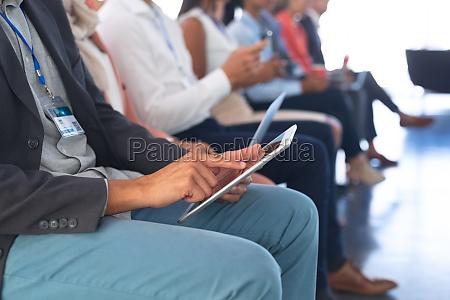 businessman using digital tablet in business