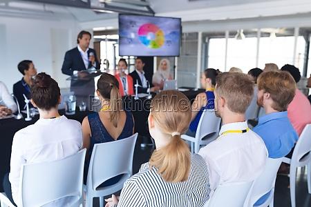audience listening male speaker in a