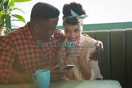 couple having fun in restaurant