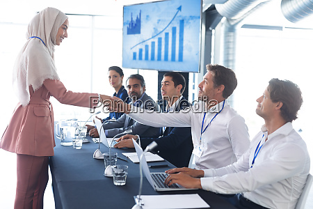 business people shaking hands with each